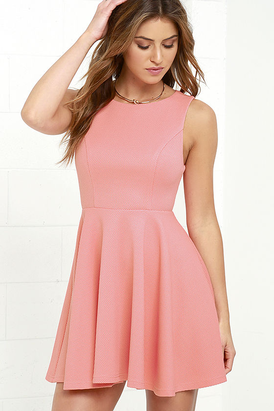 Glam up the women in you with a pink dress