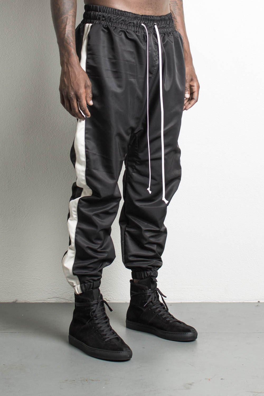 parachute track pants in black/natural by daniel patrick tzfiqlq