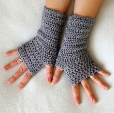 crochet gloves made these in red for winter, great to wear around the house when wefntfk