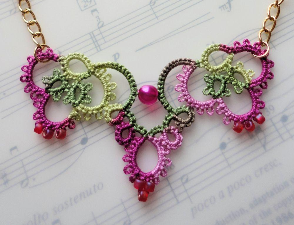 crochet jewelry pink crochet necklace laying on music book oktypof