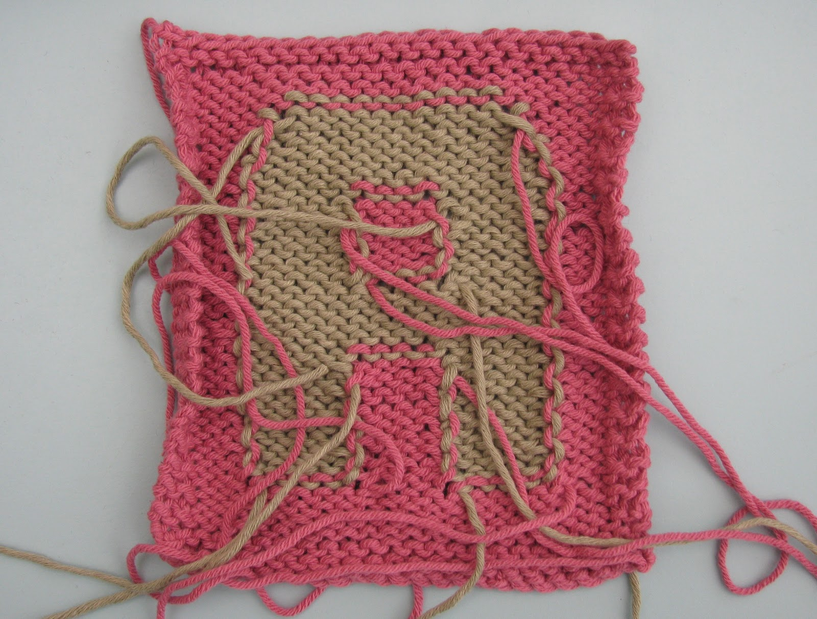 intarsia knitting tip 9 - weave the colours into the back of the same coloured flhseey