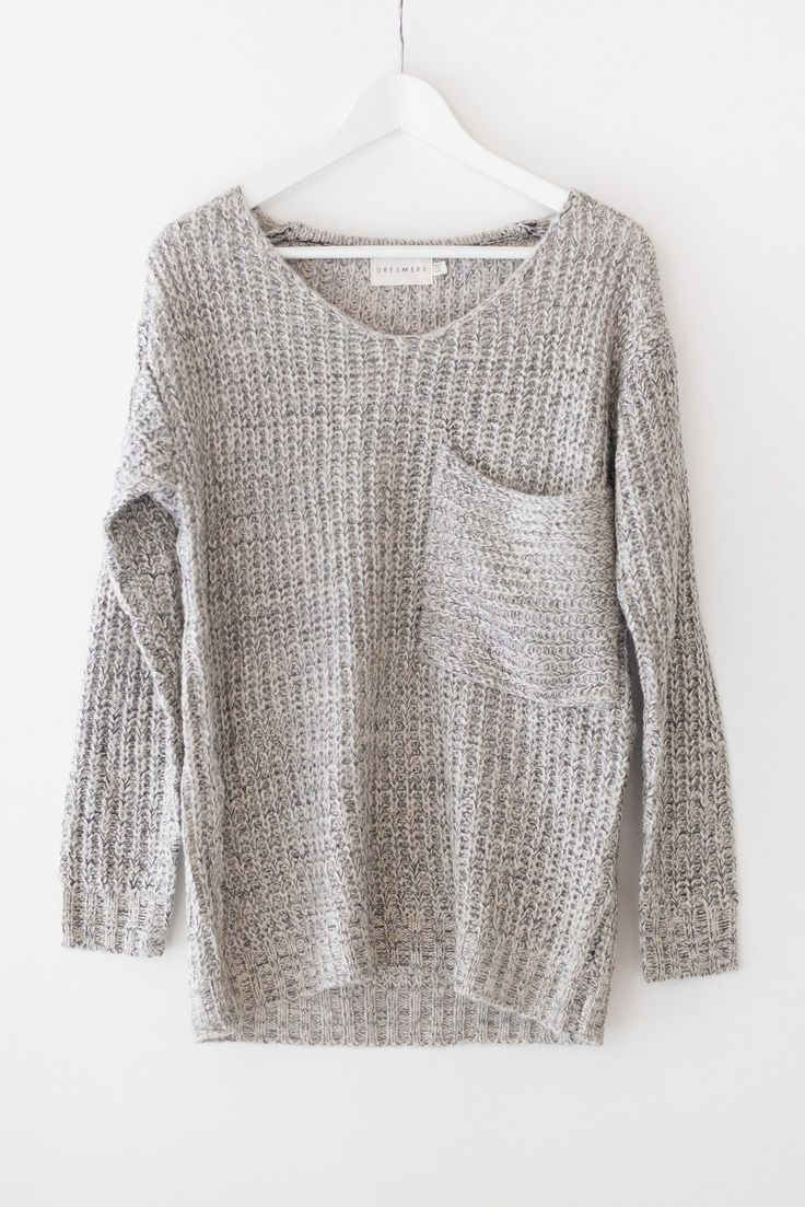 multi colored knitted sweater with an oversized fit and a large front chestu2026 miswigy