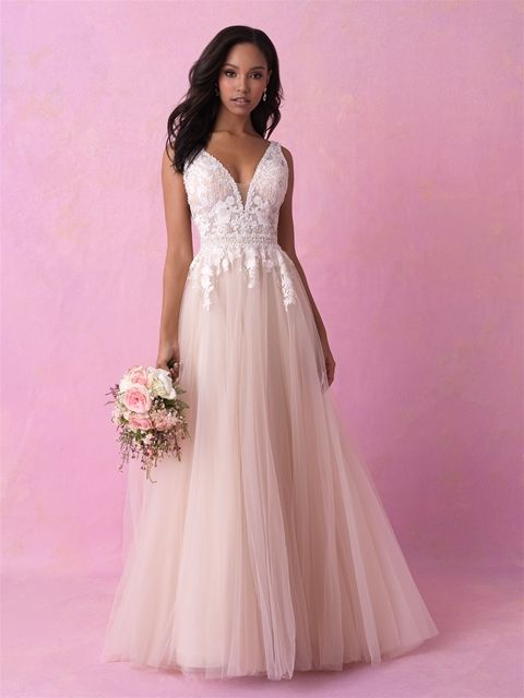 Allure Romance 3152   Sheer side panels and a dramatic neckline .