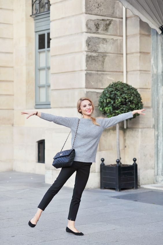 Picture Of Parisian chic style with a grey cashmere sweater, black .