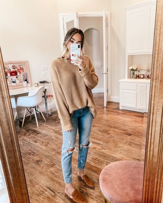 Tan sweater, distressed ripped light boyfriend jeans, tan brown .