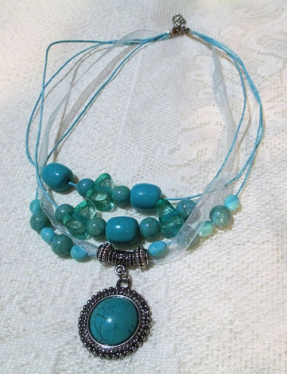 Dazzling Set of Turquoise beaded necklace & earrings. 4 strand .