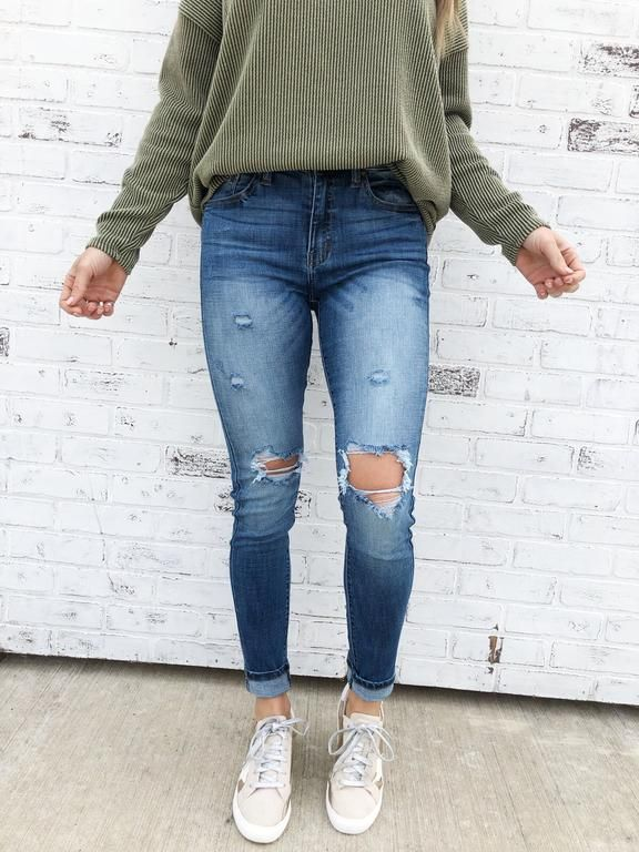 Keystone. Ripped denim jeans. Hole ripped details. Blue jeans .