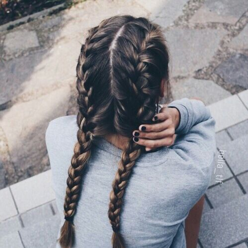 Two French Braids on Long Brown Hair with Subtle Lighter Streaks .