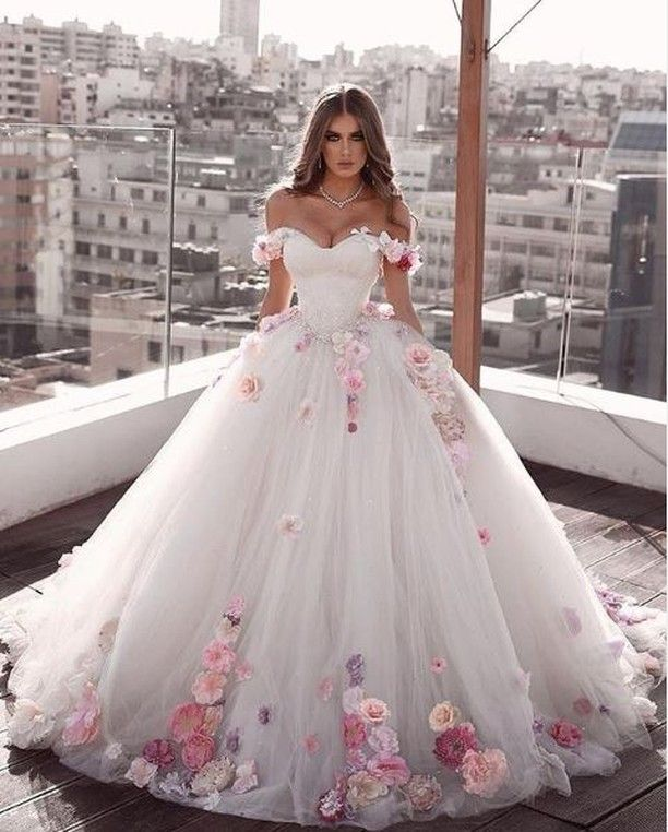 Ballgown wedding dress with floral appliques. Click for even more .