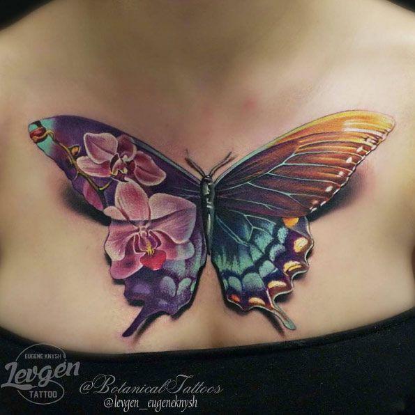 Flower Tattoos : Stunning butterfly tattoo on chest by Levgen .